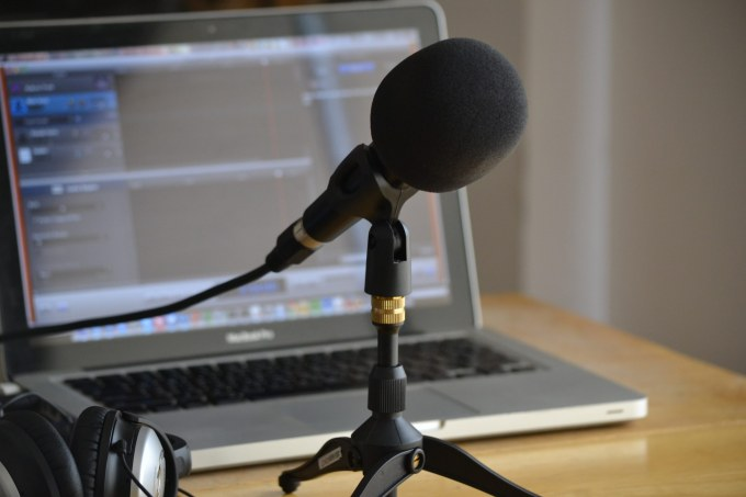 Podcasting setup with a microphone and laptop